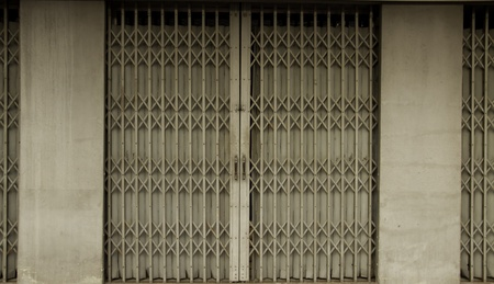 The grougy old style door at the shophouse in Bangkok Thailand. Stock Photo - 13433104