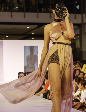 BANGKOK - MAY 2 : A model wears clothes by Thai fashion students at the fashion design contest on May 2 2012 at CTW Bangkok Thailand. Accademia Italiana teams up with f.fashion to organize this event.