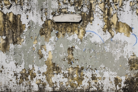 The aged grungy cement wall texture with patch as the design artwork background  Stock Photo
