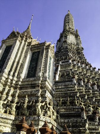 The famous Wat Arun, perhaps better known as the Temple of the Dawn, is one of the best known landmarks and one of the most published images of Bangkok. It consists of a massive elongated prang (Khmer-style tower), and is surrounded by four smaller prangs photo