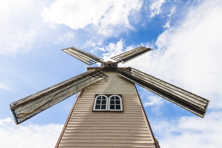 The rural landscape scene of beautiful vintyard windmill photo