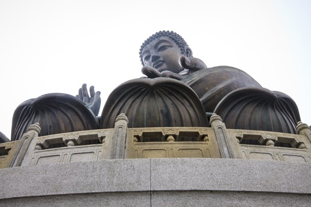 HONG KONG - JANUARY 6 : The Tian Tan Big Buddha located on the peak of the Muyu Mountain on 6 January 2013. It depicts Sakyamuni who sits on a lotus pedestal in meditation position at the Po Lin Monastery located in Ngong Ping on Lantau Island in Hong Kon photo