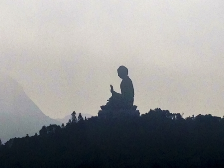 HONG KONG - JANUARY 6 : The Tian Tan Big Buddha located on the peak of the Muyu Mountain on 6 January 2013. It depicts Sakyamuni who sits on a lotus pedestal in meditation position at the Po Lin Monastery located in Ngong Ping on Lantau Island in Hong Kon Stock Photo