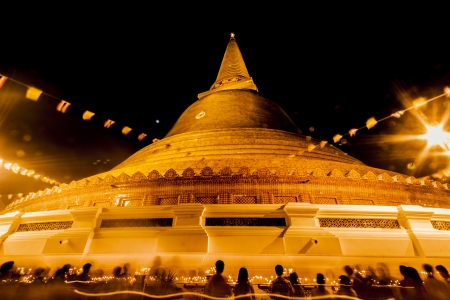 The exotic scene of beautiful golden chedi PhrapathomChedi at Nakornpathom Thailand on Vasakabuja Day  Stock Photo