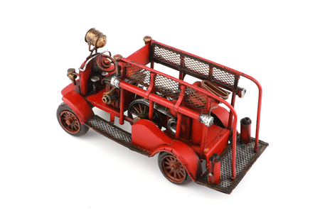 antique fire truck: Antique Fire truck model on white background Stock Photo