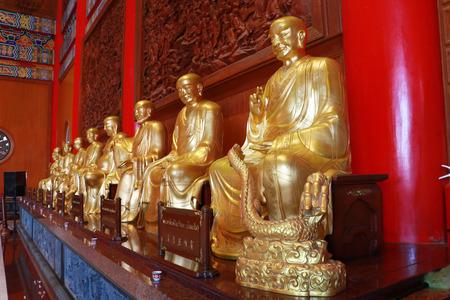lengnoeiyi: Buddha statue, stucco on chinese temple wall in Dragon Temple Kammalawat Wat Lengnoeiyi in Nonthaburi, Thailand