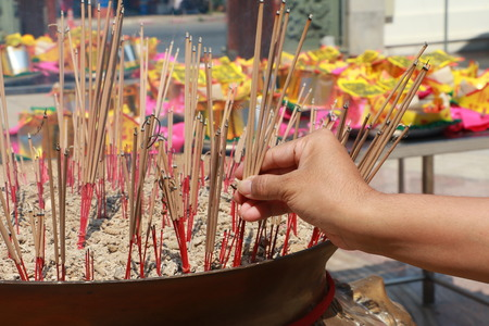 temple burn: Burning incense in Chinese temple, Joss sticks with a lot of smoke Stock Photo