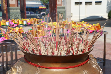 buddhism prayer belief: Burning incense in Chinese temple, Joss sticks with a lot of smoke Stock Photo