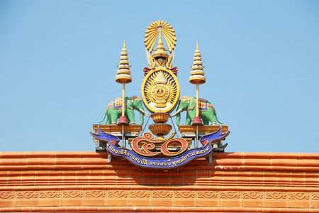 adulyadej: A traditional roof of chinese temple in Thailand decorated with royal emblem, royal seal of the King of Thailand, Bhumibol Adulyadej