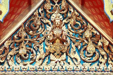 buddhist temple roof: Golden isosceles structure on Thai Temple Roof of Wat Phra Chetuphon Vimolmangklararm Rajwaramahaviharn Temple Locally known as Wat Pho Buddhist Temple, Bangkok, Thailand Stock Photo