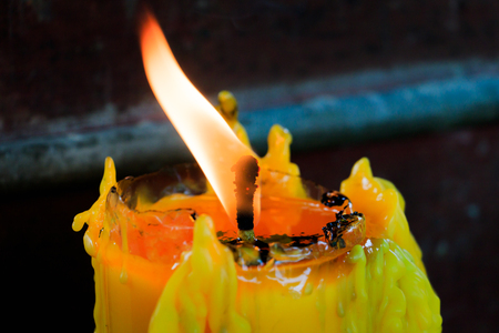 candle flame: Realistic candles glowing, Candle Flame Fire Light in Temple Stock Photo