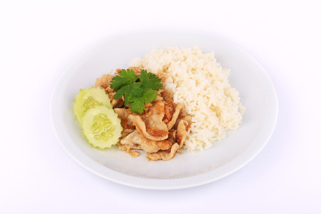 plato del buen comer: Thai Favorite Dish, Fried sliced pork with garlic with rice and cucumber in Bangkok, Thailand