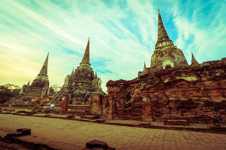 the architecture is ancient: Asian religious architecture. Ancient Buddhist pagoda ruins at Wat Phra Sri Sanphet Temple in Ayutthaya, Thailand Stock Photo