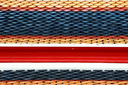 objec: Thai Temple Roof Tile Display in Thai Flag Pattern in Wat Phra Chetuphon Vimolmangklararm Rajwaramahaviharn Temple Locally known as Wat Pho Buddhist Temple, Bangkok, Thailand Stock Photo