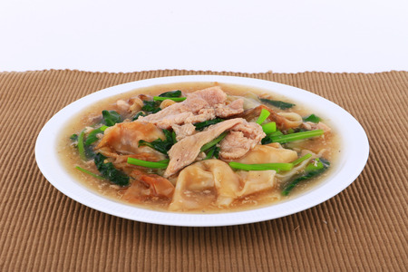 rad: The Best Thai Dishes, Wide Rice Noodles Pork in Thick Gravy, Thai Noodles Topped with Pork: Chinese and Thai Style food called Rad Na Stock Photo