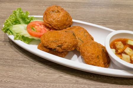 pla: Thai Fried Fish-Paste Balls, Thai Style Fish Cake Locally know as Tod Mun Pla served with Thai cucumber salad.