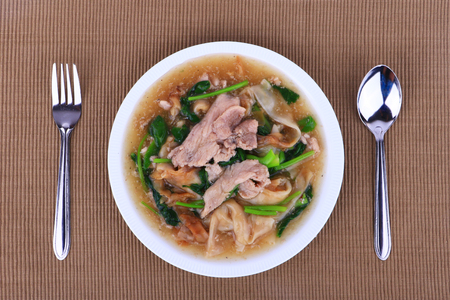 pork: The Best Thai Dishes, Wide Rice Noodles Pork in Thick Gravy, Thai Noodles Topped with Pork: Chinese and Thai Style food called Rad Na Stock Photo