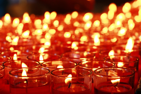 divali: Many red candles burning at Buddhist temple interior