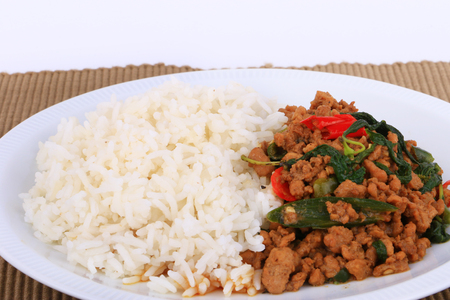 dish disk: Rice topped with stir-fried pork, fried stir basil with minced pork on white background Isolated Background Stock Photo