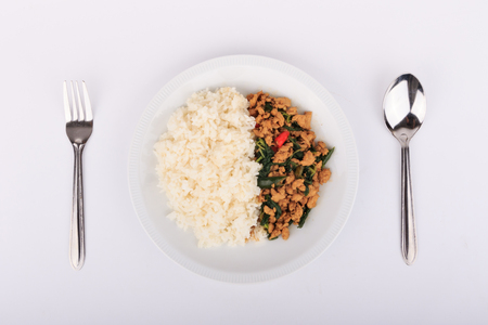 dish disk: Rice topped with stir-fried chicken and  basil, fried stir basil with minced chicken on white background Isolated Background Stock Photo