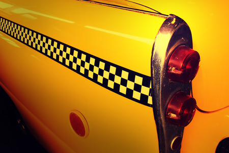 yellow cab: Yellow Cab Taxi, Back side of Taxi with Checkered line