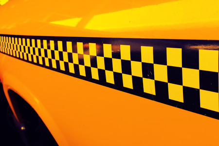 old sign: Yellow Cab Taxi, Detail on the side of Taxi Checker