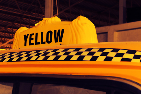 old sign: Yellow Cab Taxi, Detail on the Top of Taxi Checker