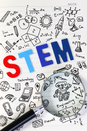 STEM education. Science Technology Engineering Mathematics. STEM concept with drawing background. Magnifying glass over education background. Banco de Imagens