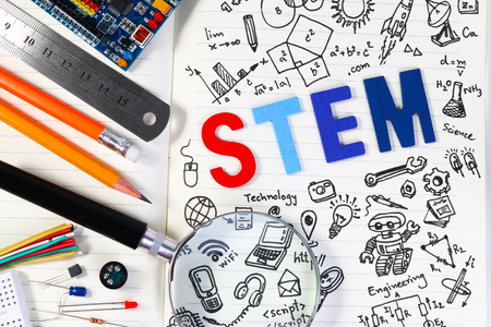 STEM education. Science Technology Engineering Mathematics. STEM concept with drawing background. Education background. Foto de archivo