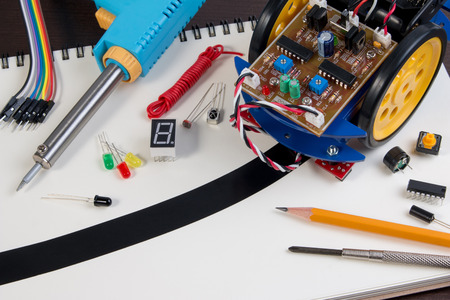 follower: Educational DIY, background of line tracking robot assembly toys.