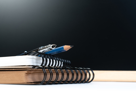 Classic graduation school background with education equipment pen, pencil, book and backboard with copyspce. Education background or back to school concept.