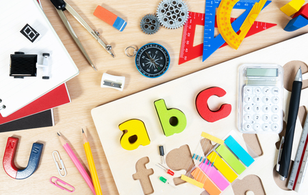 Close up of alphabet board game and basic equipment for elementary grade student for learning and playing. Wooden ABC alphabet game concept. Banco de Imagens