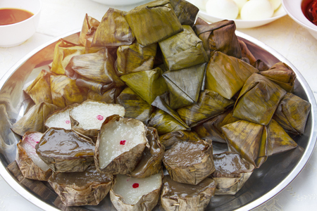 Chinese sweetmeat steamed dessert in banana leaf basket for celebration in Chinese New Year and Chinese Ghost Festival for ancestral worship. Favourite sweet dessert for ceremony.