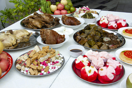 Set of favourite food for Chinese Ghost and Spirit Festival savory food, fruits and sweet for ancestor warship. Scarificial offering for ancestral worship festival. Chinese food concept.