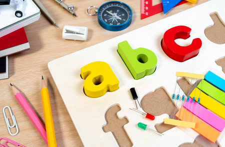 Close up of alphabet board game practicing and basic equipment for elementary grade student for learning and playing in STEM education. Wooden ABC alphabet game concept.