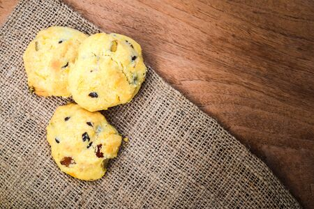 Raisin cookies and brown linen, free space for text
