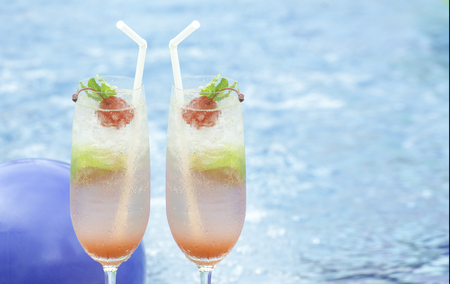 Mojito cocktail  on a swimming pool, cherry Stock Photo