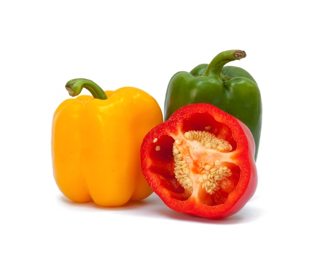 capsicum: Three sweet peppers in yellow, red and green color Stock Photo