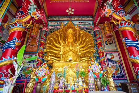 Golden Statue of Guan Yin with 1000 hands  photo
