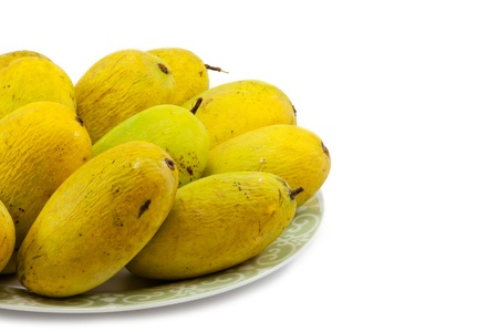 Ripe mangoe on white background Stock Photo - 9442272