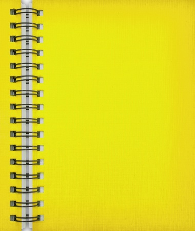 Yellow notebook baclkground Stock Photo - 9442271