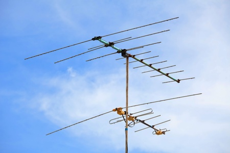 tv antenna: Television antenna with blue sky
