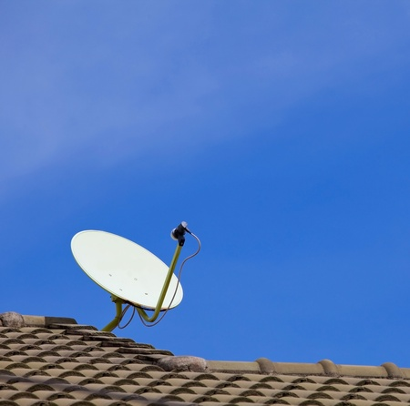 Satellite dish with sky on roof Stock Photo - 9490485