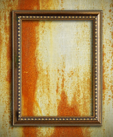 Gold frame on rust metal background Stock Photo - 9502385