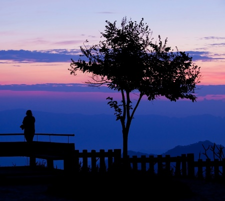 silhouette of girl on the Mountain photo