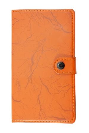 Orange notebook on white background photo