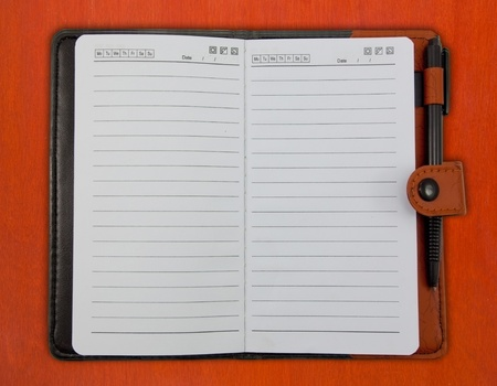 Brown Blank Note Book on wood background photo