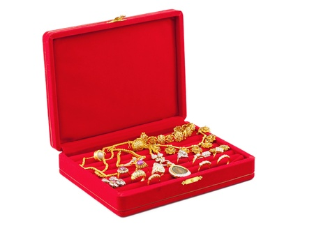golden necklaces, ring and red jewellery box photo