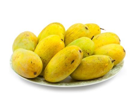 Ripe mangoe on white background photo