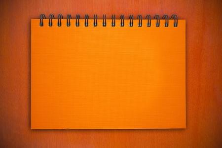 notebook on wood pattern photo